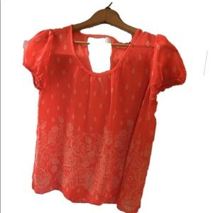 Coral colored thin small blouse.